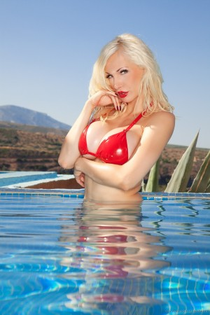 Busty blonde in the pool-147